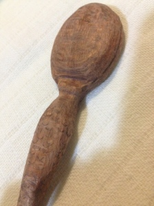 The reverse of the spoon shows that she has breasts.